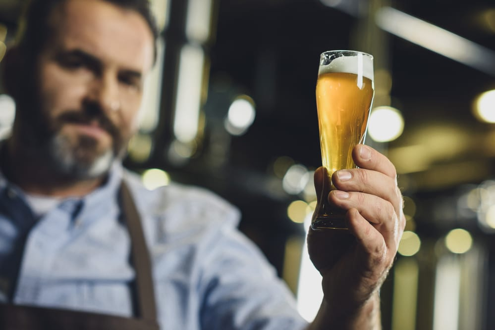 """A man holding a glass of beer —One of the premier events in Lewisville, Texas for the fall of 2018 is their """"Best Little Brewfest"""""""