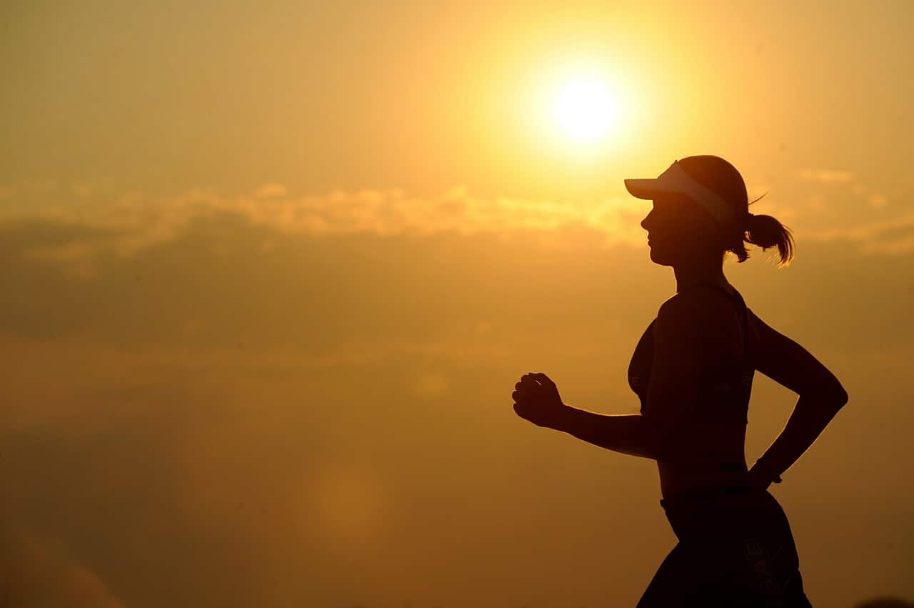 A woman running with the sun rising behind her. Cardiovascular fitness depends on testosterone in both men and women. Learn more.
