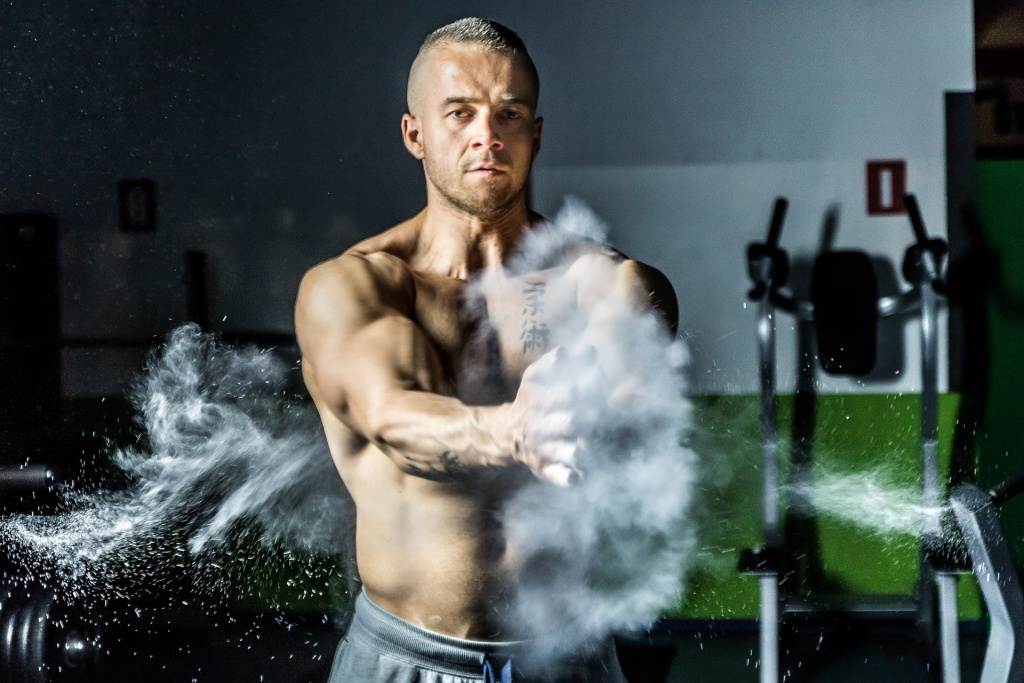 A man with his shirt off preparing to work out, clapping chalk powder into the air. If you're not careful, you can overtrain your body and damage your hormone levels even more than from simply having low testosterone. Learn more.