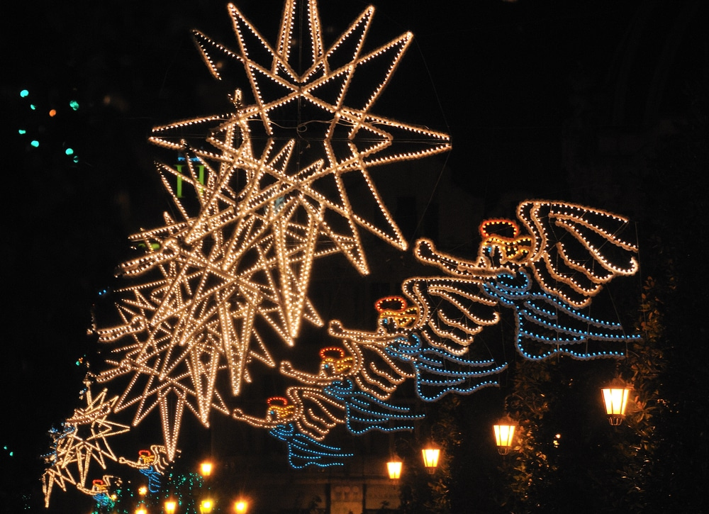 A Christmas street display of illuminated stars and angels in a row, possibly decorating one of the many holiday events in Hurst.