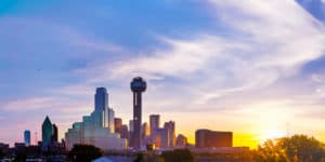 The picuture shows a morning panoramic overview of downtown Dallas, where many corporate wellness initiatives are born.