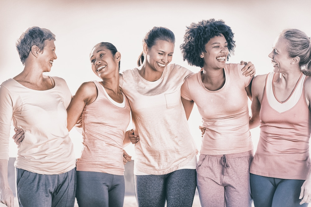 Five older women holding each other. Learn the basics of Estrogen Replacement Therapy for women.