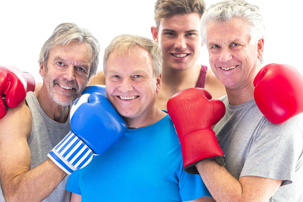 Three senior men in gloves posing with their trainer. Hypothyroidism isn't just a disease that affects women. Men can suffer from underactive thyroid too. Learn more.