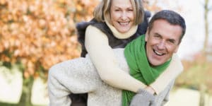 Senior man giving woman piggyback ride through autumn woods. Testosterone therapy may help a woman regain her libido, lose weight. Learn more.