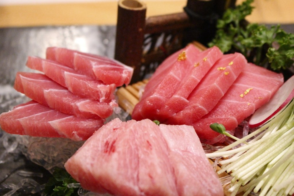3 servings of tuna sashimi are pictured. Tuna is a healthy food that can improve your nutrition and hormone balance.